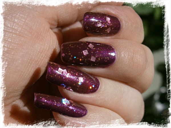 Dollish Polish A Peachy Princess över L'Oreal Wild Purple